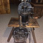 Antique sausage press and milk container