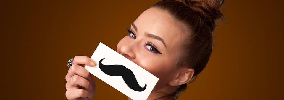 why do women get mustaches