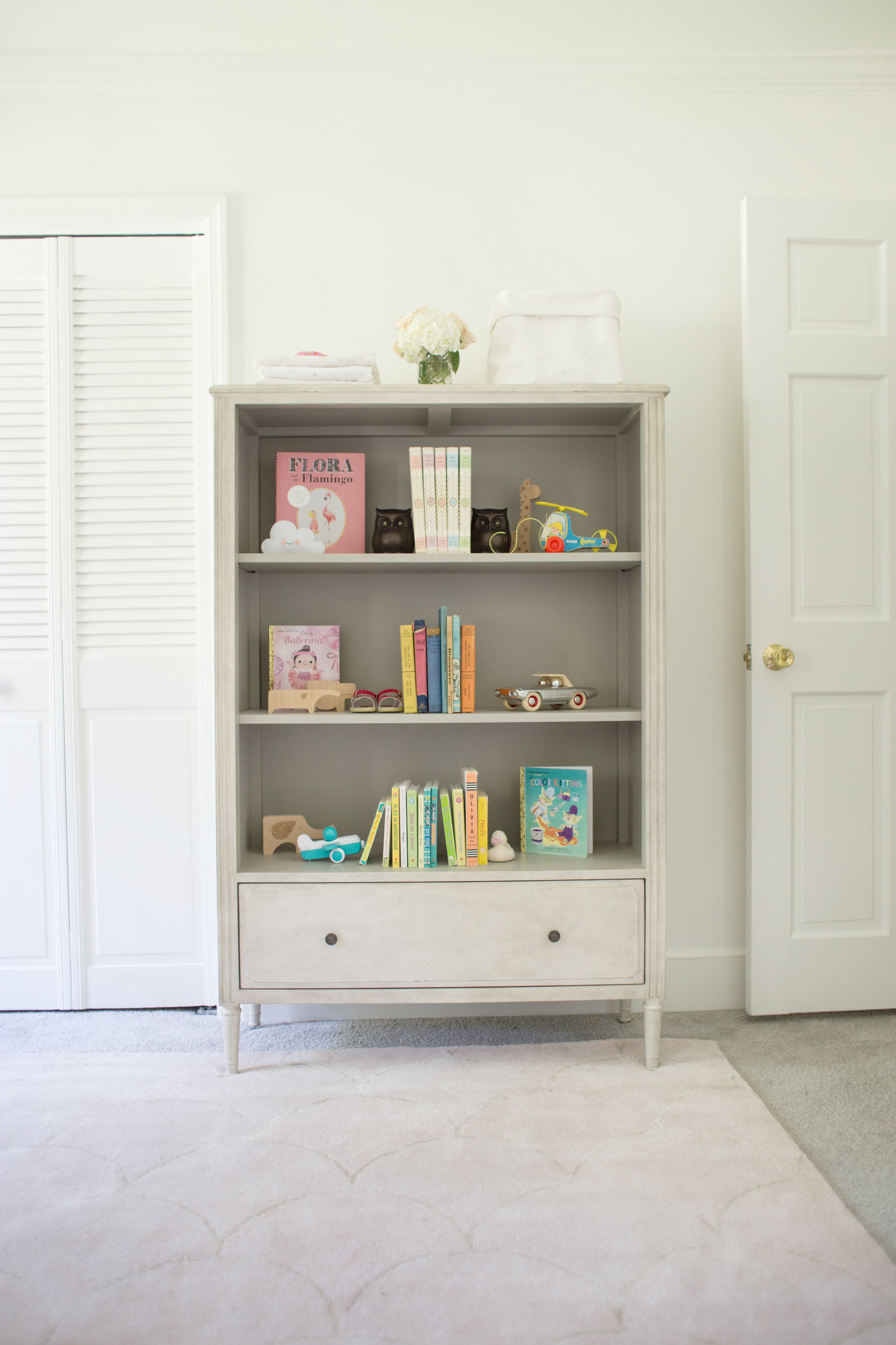 a classic polished pink nursery for a baby girl lay baby lay