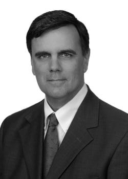 Gregory J Commins