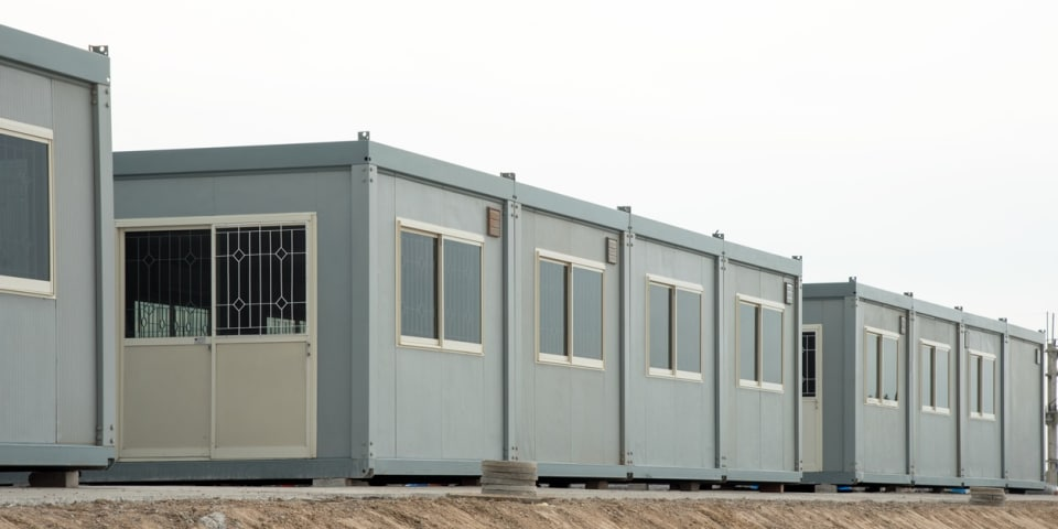 Temporary shelters group sells US subsidiary after noteholders settlement
