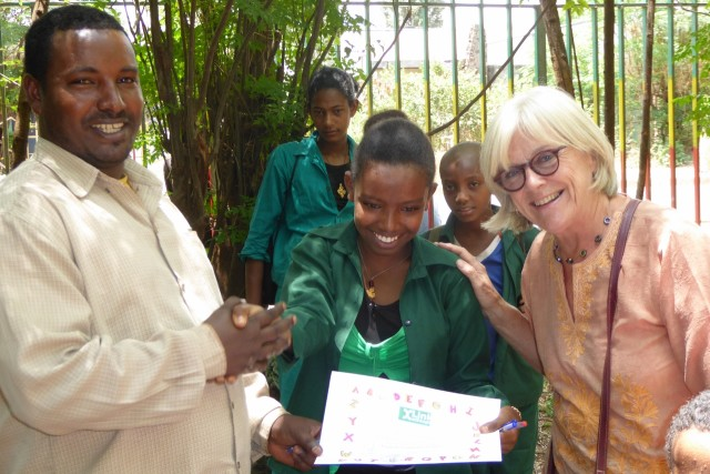 Mulusew, school director presents Betelhem with her certificate