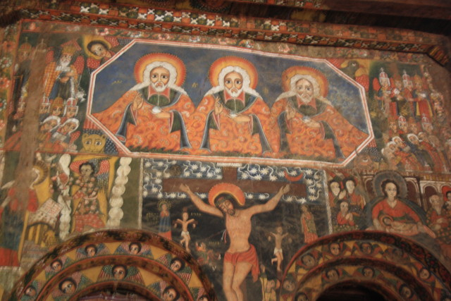 The holy trinity above the altar of the church