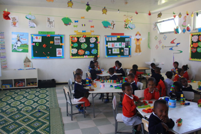 One of the first classes at the new St. George's School enjoys learning in this colourful and stimulating environment.