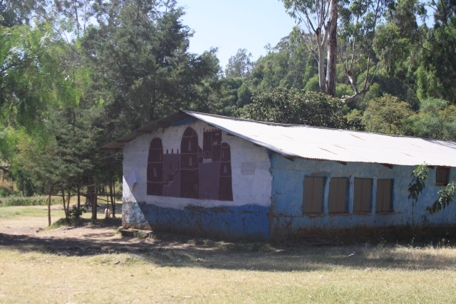 A mural of Gondar castle at Arbatu Ensesa School. This mud and wood structure with corrugated iron roof is a typical classroom design at government schools that I have seen in the North and the South. Link Ethiopia funded the metal shutters and doors to improve security and added cement flooring replacing mud and dust (which had made some children ill).