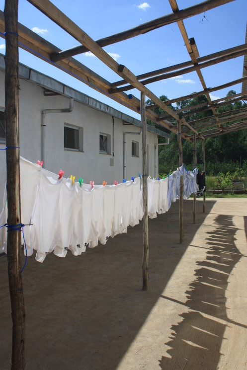 School uniforms hanging out to dry at St. George's. The school provides uniforms and materials as priority is given to orphans and children from poor families.