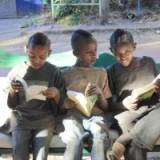 kids from the neighbourhood reading