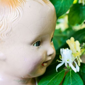 Vintage Doll Smelling Flower - Photography