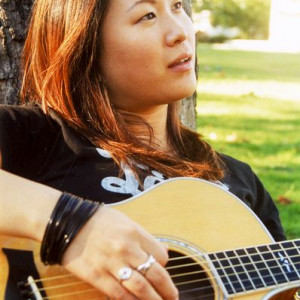 Neah Lee - Playing Guitar on the Grass - Photography