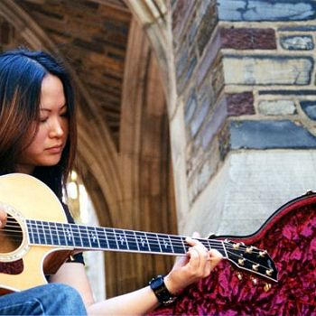 Neah Lee - Playing Guitar on the Steps with Maroon Case - Photography