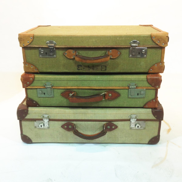 1: Stack of Green Vintage Canvas Suitcases