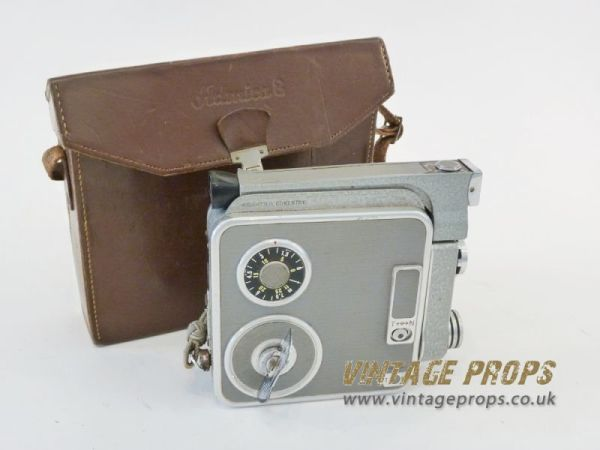 1: Vintage 8mm movie camera with leather case