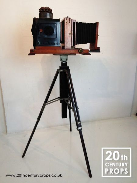 1: Vintage plate camera and tripod