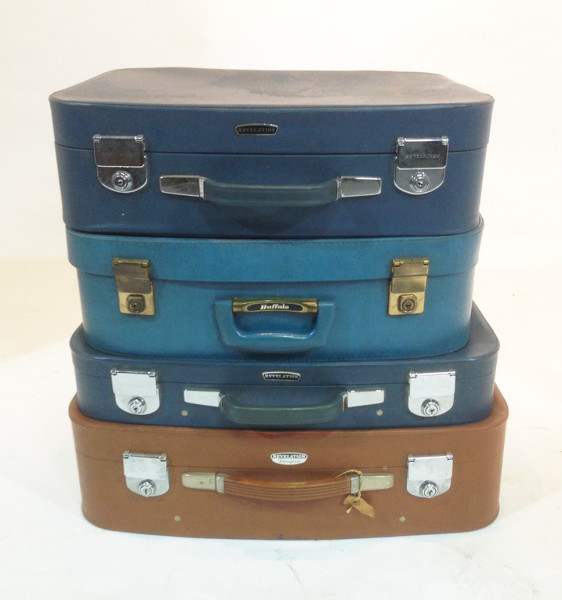 1: Stack of Different Coloured Retro Soft Leather Suitcases
