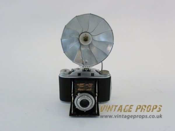 2: Vintage camera with flash reflector