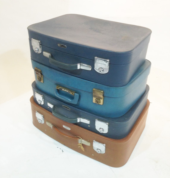 3: Stack of Different Coloured Retro Soft Leather Suitcases