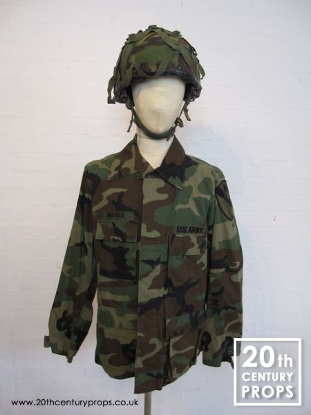 1: US Army jacket and camouflage helmet