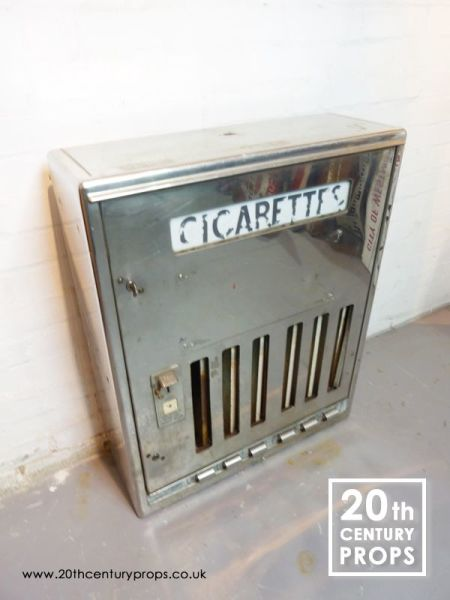 1: 1950's chrome cigarette vending machine