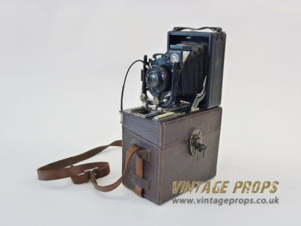 1: Vintage folding camera in leather case