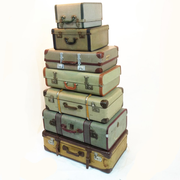 3: Stack of Yellow to Green Coloured Vintage Travel Cases