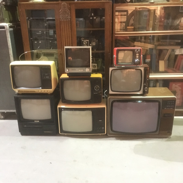 5: Stack of vintage TV's
