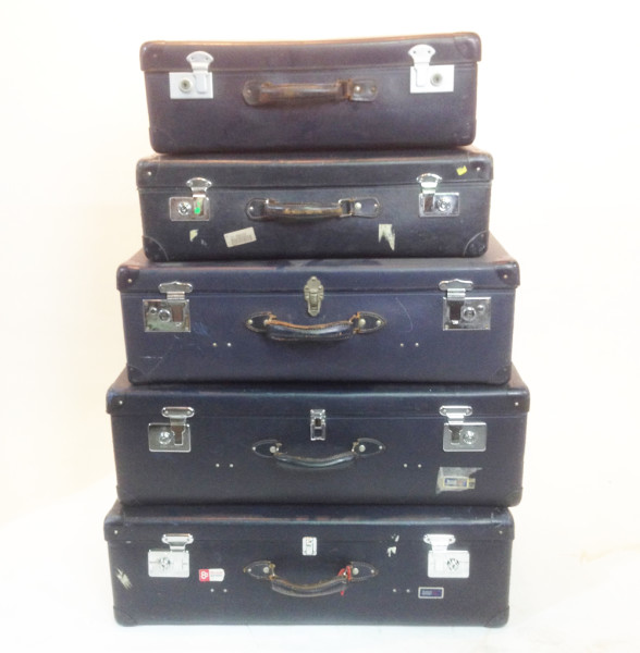 1: Stack of Matching Navy Blue Vintage Suitcases