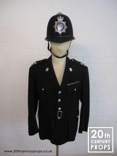 VIntage policemans jacket and helmet