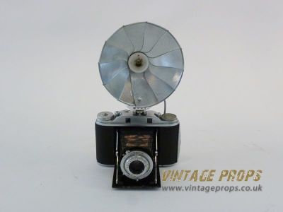 Vintage camera with flash reflector