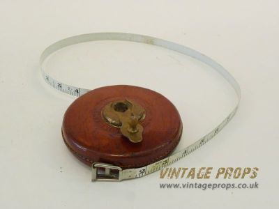 Leather cased measuring tape