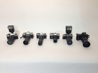 Paparazzi cameras with long lenses
