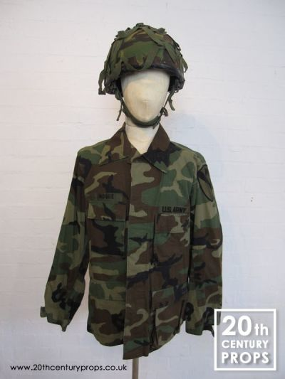US Army jacket and camouflage helmet
