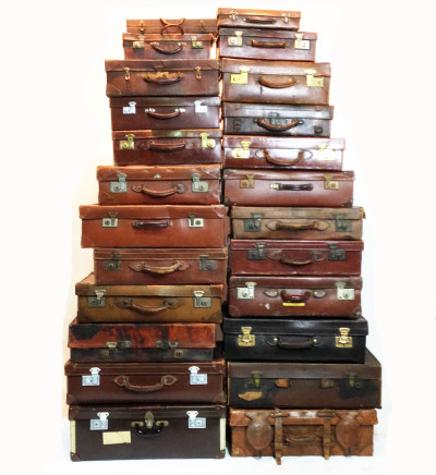 Large Stack of Various Brown Leather Suitcases