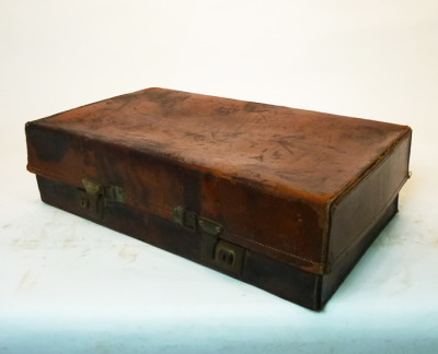 Stained Brown Vintage Leather Suitcase