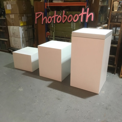 White plinths with illuminated tops