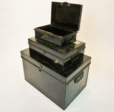 Stack of Small Black Matching Metal Chests
