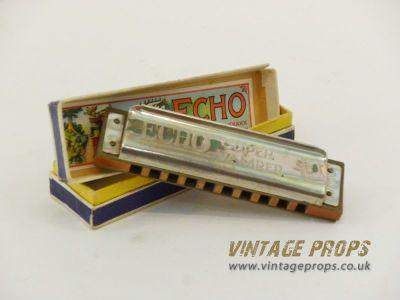 Vintage harmonica in box