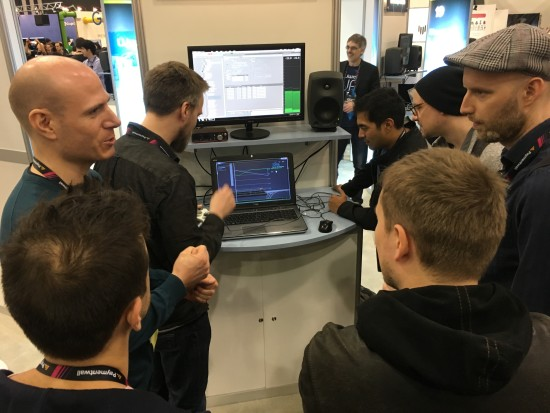 Martin, Jakob and a few curious minds surround the INSIDE demo station at the Audiokinetic booth at GDC 2016.