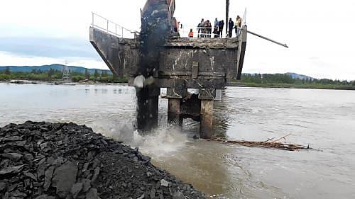 Завершаются работы по устранению размыва у моста р. Эльги в Магадане « автомагадан