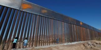 Children play at a newly built section of the US-Mexico border wall at Sunland Park, US opposite the Mexican border city of Ciudad Juarez