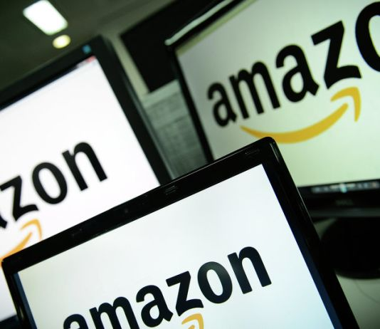 A picture shows the logo of the online retailer Amazon dispalyed on computer screens in London on December 11, 2014