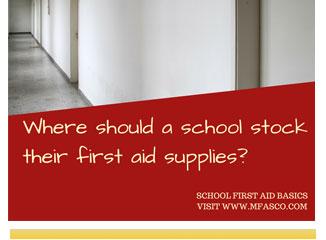 Where should a school keep their first aid supplies?