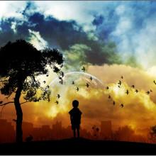 Child standing near tree