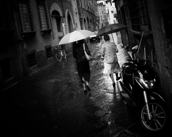 Two umbrellas and a bicycle