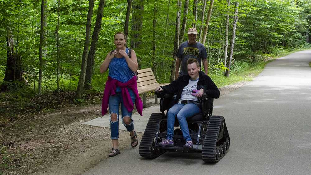 A track chair donated by Kali's Cure in useat Tahquamenon Falls State Park