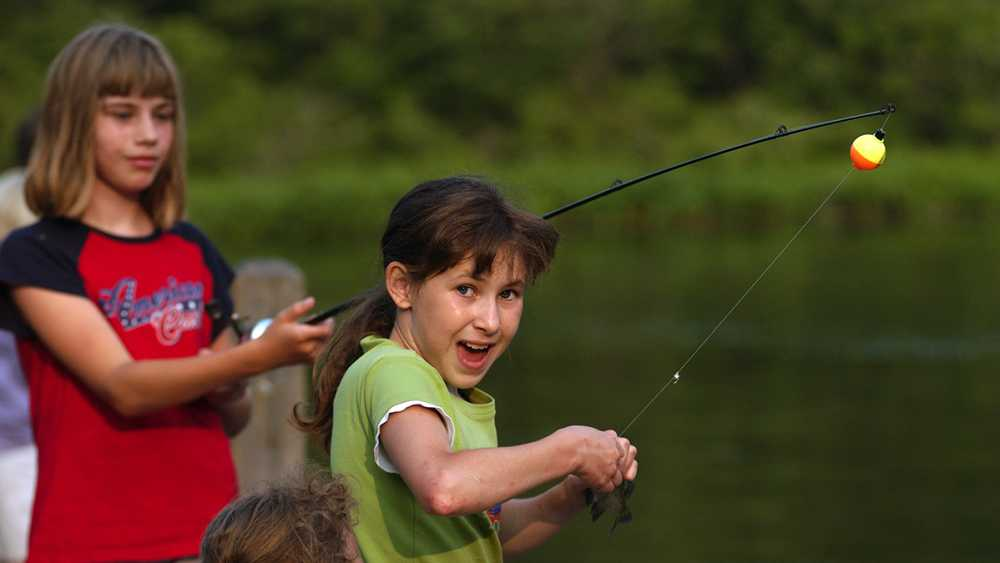 Girls fishing on a pier at Yankee Springs Recreation Area.