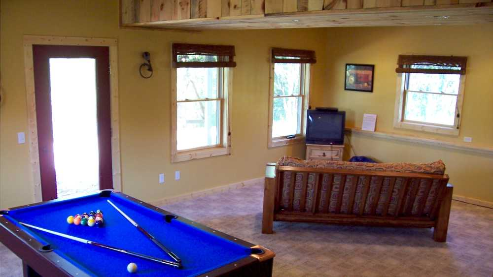 Pool Table with separate TV viewing area for kids. PS2w/Games