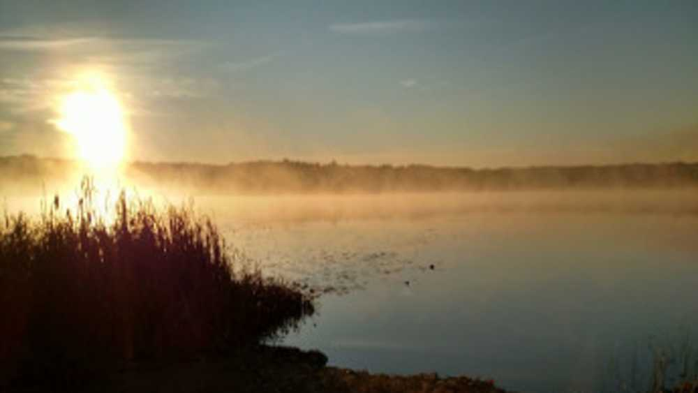 Steam rises above the lake at Waterloo Recreation Area