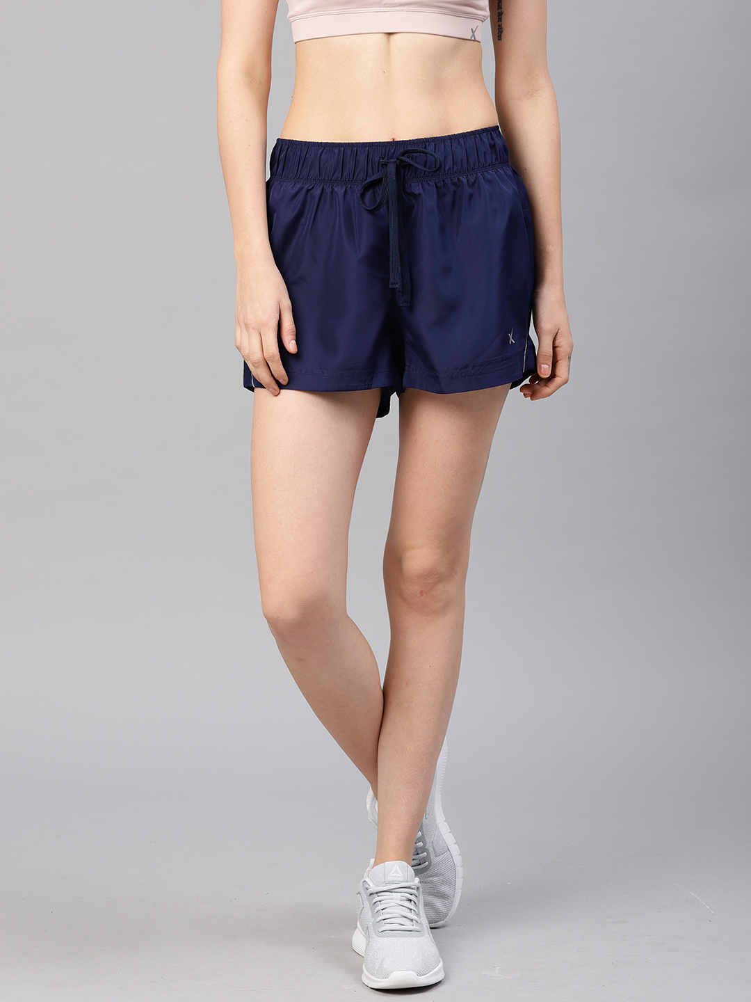 HRX by Hrithik Roshan Women Blue Solid Regular Fit Regular Shorts Price in India