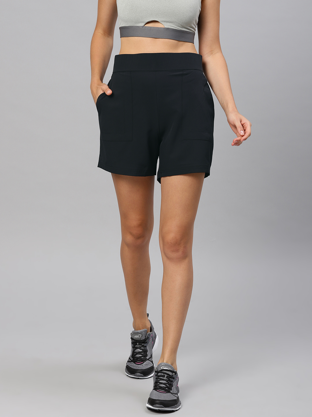 HRX by Hrithik Roshan Women Black Solid Regular Fit Sports Shorts Price in India