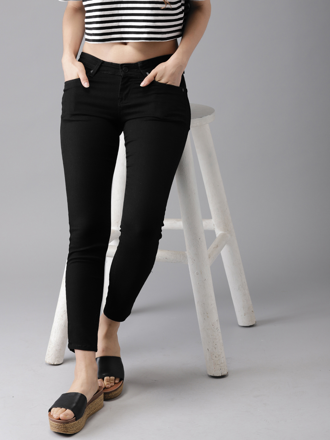 Moda Rapido Women Black Skinny Fit Mid-Rise Ankle Length Clean Look Stretchable Jeans Price in India